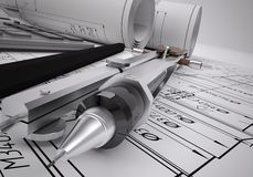 Scrolls engineering drawings and tools stock photo