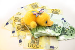 Scrooge and Euro banknotes. Young Scrooge with Euro banknotes Stock Image