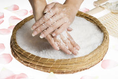 Scrub hands with salt Royalty Free Stock Photography