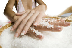 Scrub hands with salt Royalty Free Stock Images