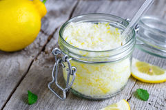 Scrub made of sea salt, lemon peel and lemon juice royalty free stock images