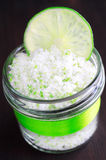 Scrub made of sea salt, lime peel and lime juice Stock Images