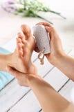 Scrub, scrub with pumice dead epidermis Royalty Free Stock Photos