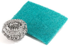 Scrub sponge and silver potsponge for cleaning Royalty Free Stock Images