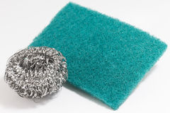 Scrub sponge and silver potsponge for cleaning Royalty Free Stock Photo