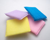 Scrubber. Yellow, pink and blue kitchen sponges, isolated on a white background Royalty Free Stock Photography