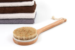 Scrubber with towels. Various towels and a scrubber with a white background Royalty Free Stock Photography