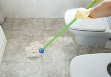 Scrubbing the bathroom floor Royalty Free Stock Images