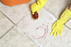 Scrubbing the floor Stock Photography