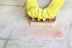 Scrubbing the floor Stock Photos
