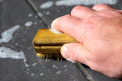 Scrubbing floor tiles Stock Images