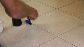 Scrubbing Grout in a Bathroom Tile Floor stock video
