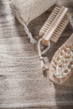 Scrubbing loofah massager bath brush on wooden board spa treatme Stock Photos