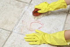 Scrubbing the tiles Stock Photography