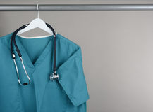 Scrubs with Stethoscope on Hanger Horizontal Stock Image
