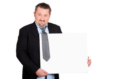 Scruffy businessman with a board Stock Photography
