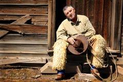 Scruffy Cowboy on Stoop stock photos