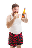 Scruffy Man Eats Sub Sandwich Royalty Free Stock Images