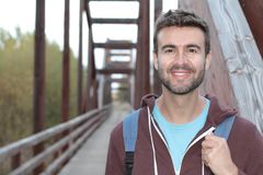 Scruffy outdoorsy man smiling close up.  Royalty Free Stock Image