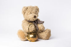 Scruffy teddy bear with copper kettle on white background Stock Photo