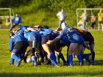 Scrum. A rugby scrum pushes against each other Royalty Free Stock Photography