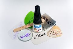 Scrum glue for software development. A bottle of metaphorical `SCRUM glue` with other parts of software development domain. Glues together all parts to make Stock Photography