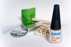 Scrum glue for software development. A bottle of metaphorical `SCRUM glue` with other parts of software development domain. Glues together all parts to make Royalty Free Stock Photography