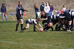 A Scrum in a Women's College Rugby Match. A scrum in a women's collegiate rugby match between Navy and the Brigham Young University (BYU) Cougars in the NCAA Royalty Free Stock Image