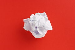 Paper Ball on Red Background Stock Photos