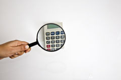 Scrutiny. Calculateing and scrutinizing the financials Royalty Free Stock Photo