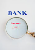 Scrutiny of the banks: bonuses. A magnifier focusing on bonuses followed by question marks with the word  bank shown blue and  bold above it. The image Royalty Free Stock Image