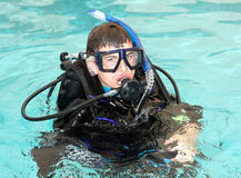 Scuba. Young boy taking scuba diving lessons in a home pool Stock Photography
