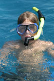 Scuba boy in the ocean vertical. Scuba boy swimming in the ocean royalty free stock images