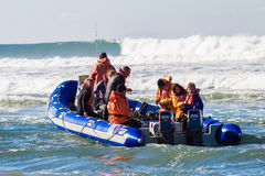 Scuba Divers Boat Beach Launch Stock Images