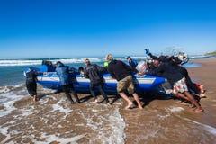 Scuba Dive Boat Crew Beach Launch Stock Photography