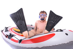 Scuba diver. And his boat isolated on the white background Stock Photos