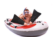 Scuba diver. And his boat isolated on the white background Royalty Free Stock Image