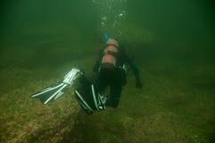 Scuba diver. A women that scuba dive in a northern sea stock photos