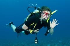 Scuba diver. Waves at the camera Stock Photos
