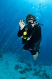 Scuba diver. Male scuba diver gives OK sighn underwater Stock Image