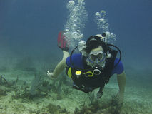 Scuba diver. Male scuba diver swimming in a reef Stock Photo