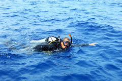 Scuba diver. Male scuba diver in swimming in the blue sea Stock Photo