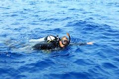 Scuba diver. Male scuba diver in swimming in the blue sea stock photo