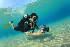 Scuba Diver. Woman Scuba Diver in tropical sea stock photography