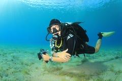Scuba Diver. Woman Scuba Diver in tropical sea royalty free stock photo