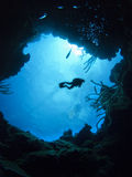 Scuba Diver above underwater cave Royalty Free Stock Photos