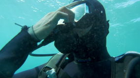Scuba diver in blue water on sunny day stock video footage