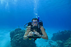 Scuba diver with camera, Cozumel, Mexico Stock Photos