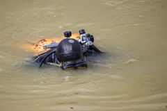 Scuba diver clean garbage from river Stock Images