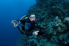 scuba diver and coral and camera Royalty Free Stock Images